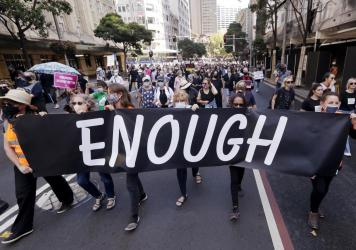 Thousands of people with placards and banners rally in Sydney on Monday, demanding justice for women. The rally was one of several across Australia including in Canberra, Melbourne, Brisbane and Hobart.