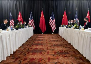 Secretary of State Antony Blinken, second from right, joined by national security adviser Jake Sullivan, right, speaks while facing Chinese Communist Party foreign affairs chief Yang Jiechi, second from left, and China's State Councilor Wang Yi, left, at