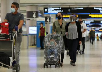 With precautions such as mask-wearing in place, experts predict travel is among the activities that may become safer by this summer.