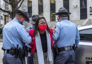State Rep. Park Cannon is placed into the back of a Georgia State Capitol patrol car after being arrested at the Georgia State Capitol Building. Cannon was arrested after she attempted to knock on the door of the Gov. Brian Kemp office during his remarks
