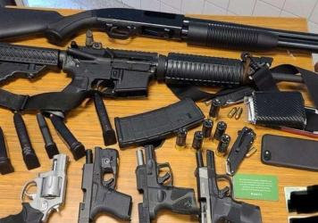 The weapons the suspect was armed with at the time of his arrest at an Atlanta grocery store Wednesday.