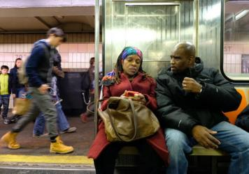 Sheila Rule and Joe Robinson take the subway to a Riverside Church Prison Ministry meeting in Manhattan on Nov. 20, 2016. Rule and Robinson, married for almost 12 years while Joe was still incarcerated, are here together for the first time since he was r