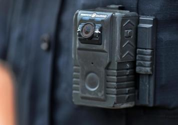 Police officer David Moore is pictured wearing a body camera in Ipswich, Mass., on Dec. 1, 2020. The city was among 25 statewide awarded grants to purchase body-worn cameras for videotaping interactions with the public. A new study says the benefits to s
