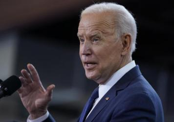 President Biden delivers a speech Wednesday unveiling his infrastructure proposal at a carpenter's training center in Pittsburgh.