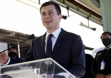 "U.S. Secretary of Transportation Pete Buttigieg speaks to Amtrak employees Feb. 5 during a visit at Union Station in Washington, D.C. In a Thursday interview with NPR's <em>Morning Edition</em>, he said not making infrastructure investment would be a ""th"