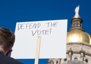 Demonstrators protest House Bill 531 last month in Atlanta. The sweeping legislation signed into law has drawn criticism from voting rights activists and businesses, who say it limits access to the polls and disproportionately harms voters of color.