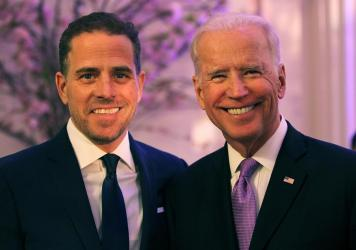 Hunter Biden, at the time serving as board chairman of World Food Program USA, with then-Vice President Joe Biden in 2016. Hunter Biden says his addictions worsened after his brother Beau's death in 2015.