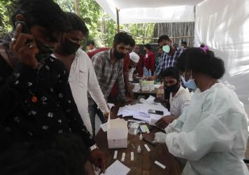People wait for coronavirus tests outside a court in Mumbai on Monday as India reported its biggest single-day spike in confirmed coronavirus cases since the pandemic began.