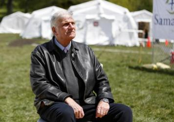 The Rev. Franklin Graham, president and CEO of Samaritan's Purse, sits for a portrait at his group's field hospital in New York's Central Park in May. Graham has spoken out in support of COVID-19 vaccines.