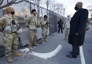 "Defense Secretary Lloyd Austin visits National Guard troops deployed at the U.S. Capitol on Jan. 29. The troops were deployed in the wake of the Jan. 6 Capitol attack. Under Austin's order, all military units are holding ""stand downs"" to discuss extremis"