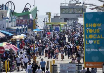The Santa Monica Pier welcomed outdoor visitors on Monday as Los Angeles County entered the less-restrictive orange tier. The following day, California Gov. Gavin Newsom announced a target statewide reopening date of June 15, provided certain public heal