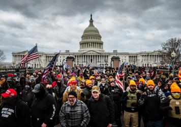 Pro-Trump rioters, including members of the far-right extremist group the Proud Boys, gather near the U.S. Capitol on Jan. 6. At least 25 people charged in the attack appear to have links to the Proud Boys, according to court documents.