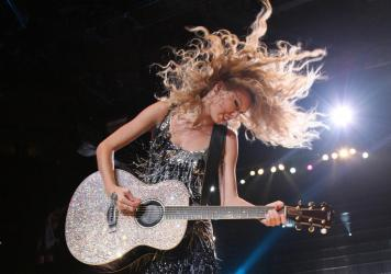 Taylor Swift, onstage during the Fearless Tour at Madison Square Garden on Aug. 27, 2009 in New York. Swift released a re-recorded version of her 2008 album <em>Fearless </em>on April 9, 2021.