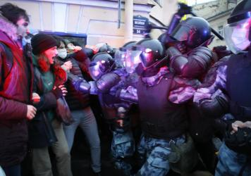 People clash with police during a protest in support of jailed opposition leader Alexei Navalny in St. Petersburg, Russia, Wednesday. A human rights group that monitors political repression said at least 1,700 people were arrested across the country in c