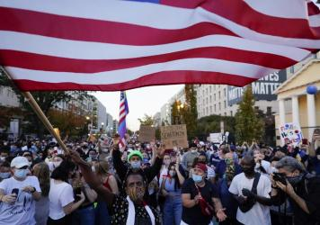 People gather in Black Lives Matter Plaza to celebrate president-elect Joe Biden's win over President Donald Trump on Nov. 7 in Washington, D.C. A new Harvard poll shows the youngest voting-age Americans are more politically active and optimistic about t