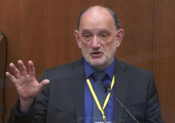 A video still shows Dr. David Fowler, the retired chief medical examiner for the state of Maryland, testifying in the trial of former Minneapolis police Officer Derek Chauvin on April 14 in Minneapolis. Maryland officials say there will be an independent
