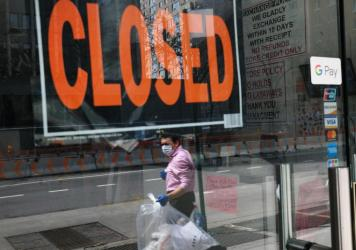 A closed sign is displayed in the window of a business in a nearly deserted lower Manhattan on April 17, 2020, in New York. Many small businesses benefited from a government emergency loan program during the pandemic, but its effectiveness is still in do