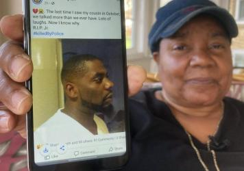 Andrew Brown Jr. was shot in the back of his head, his family's attorneys said Tuesday, citing an independent autopsy. Here, Glenda Brown Thomas displays a photo of Brown, her nephew, on her cellphone at her home in Elizabeth City, N.C.