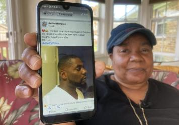 Glenda Brown Thomas displays a photo of her nephew, Andrew Brown Jr., on her cellphone at her home last week in Elizabeth City, N.C. Brown was shot and killed by sheriff's deputies attempting to execute a warrant.