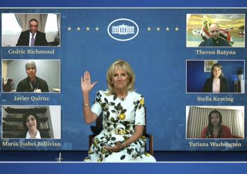 An image from video provided by the White House shows first lady Jill Biden meeting with her virtual guests ahead of President Biden's joint address on Wednesday. Many Democratic lawmakers are also naming guests of honor, who will be watching the speech