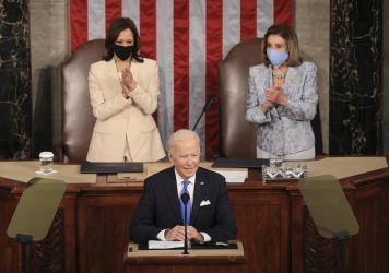 In a historic first, President Biden was flanked by two women — House Speaker Nancy Pelosi and Vice President Harris — as he addressed a joint session of Congress at the U.S. Capitol on Wednesday.