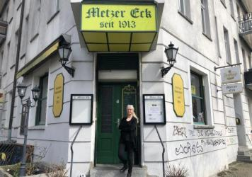 Sylvia Falkner stands in front of her Berlin pub, Metzer Eck, which has been owned by four generations of the same family since 1913. She is one of thousands of small German business owners struggling to keep their businesses open in an extended pandemic