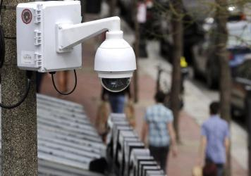 Surveillance cameras, like the one here in Boston, are used throughout Massachusetts. The state now regulates how police use facial recognition technology.