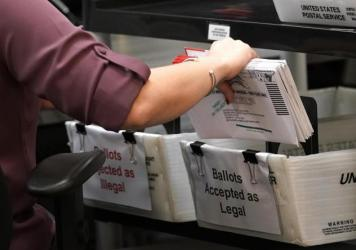 An election worker sorts vote-by-mail ballots at the Miami-Dade County Board of Elections in Doral, Fla., on Oct. 26, 2020. The Florida Legislature on Thursday approved a bill that would alter how residents can vote by mail.