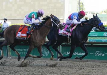 John Velazquez, right, rides Medina Spirit ahead of Florent Geroux aboard Mandaloun to win the 147th running of the Kentucky Derby at Churchill Downs on Saturday in Louisville, Ky.