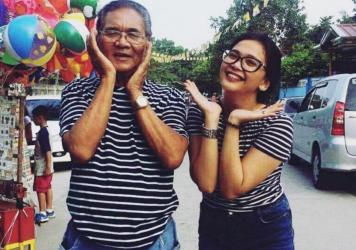 Nardo Samson posing with granddaughter Kiara Bautista, May 2017.