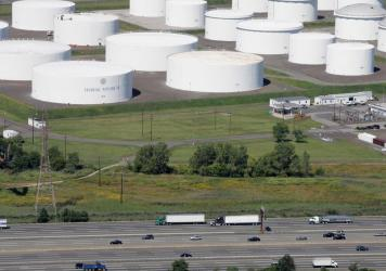 Traffic on I-95 passes oil storage tanks owned by the Colonial Pipeline Co. in Linden, N.J. An cybersecurity attack has shut down Colonial Pipeline, a major transporter of gasoline along the East Coast.