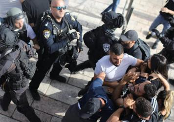 Undercover Israeli security force members arrest a Palestinian protester at Damascus Gate in Jerusalem on Monday.