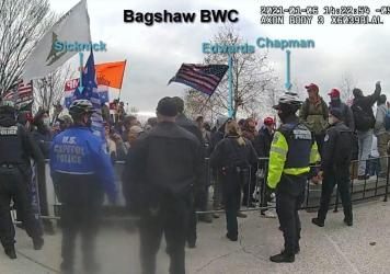 This image from a video released by the Justice Department shows Capitol Police officers, including Brian Sicknick, attempting to hold back a crowd that ultimately breached the U.S. Capitol on Jan. 6.