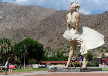 The 'Forever Marilyn' statue by artist Seward Johnson was first in Palm Springs from 2012 to 2014. Now, she's headed back to the resort town permanently. But her return is sparking a backlash.