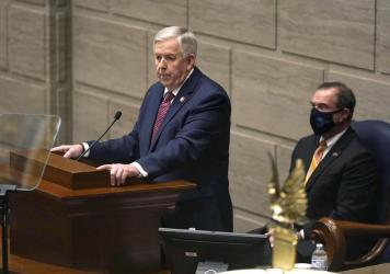 """Missouri Gov. Mike Parson, a Republican, at this year's State of the State address in Jefferson City, Mo., when he declared he would """"uphold the will of the voters"""" in expanding Medicaid. He reversed course on Thursday."""