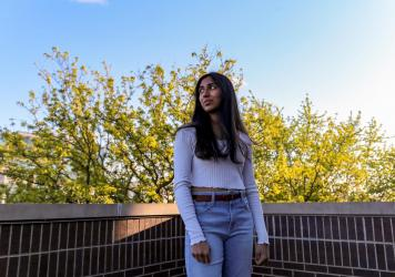 NPR Student Podcast Challenge winner Kriti Sarav poses for a portrait while on the top balcony of her family's home in Chicago.