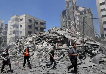 People inspect the rubble of a residential building that was destroyed by an Israeli airstrike in Gaza City on Sunday.
