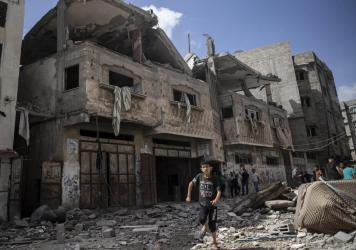 Palestinians inspect damaged houses that were hit early Monday in Israeli airstrikes in Gaza City, Gaza Strip.