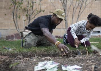 """Ietef """"DJ Cavem Moetavation"""" Vita plants seeds with daughter Libya LeaDonvita in the garden at their home outside Denver. Vita is among a growing list of Black gardening enthusiasts-turned-entrepreneurs across the country who've launched seed businesses"""
