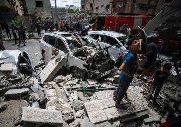 Young Palestinians inspect the damage an Israeli attack inflicted on houses in the Sabra neighborhood of Gaza City. A man who lives in the middle of the Gaza Strip says his family is traumatized by the violence.