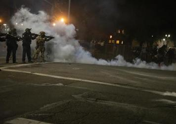 Federal law enforcement officers fire impact munitions and tear gas at protesters demonstrating against racism and police violence in front of the Mark O. Hatfield federal courthouse in Portland, Ore., on July 16, 2020. Through the end of 2020, the major