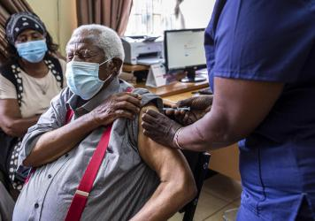 An older person receives their first dose of the AstraZeneca vaccine in Thika, Kenya. The vaccine's manufacturer, Serum Institute of India, announced this week that it will freeze all exports of the vaccine through the end of this year — leaving 20 mil