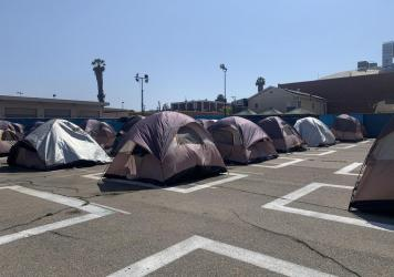 A city-sanctioned encampment for homeless people in Los Angeles includes 70 tents and provides bathrooms, showers and 24-hour security.