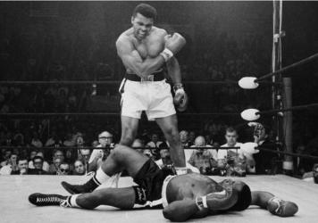 Heavyweight champion Muhammad Ali stands over fallen challenger Sonny Liston on May 25, 1965, in Lewiston, Maine. The bout lasted only one minute into the first round. Ali is the only man ever to win the World Heavyweight Boxing Championship three times.