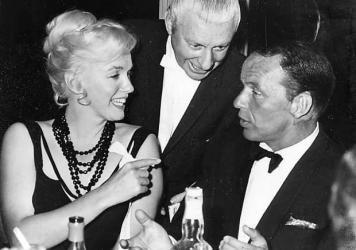 Marilyn Monroe talks with Frank Sinatra at Cal Neva Resort