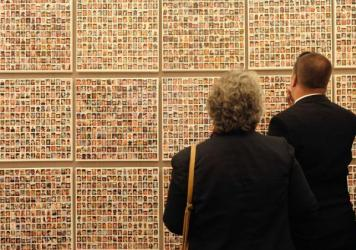 Two people at the wall