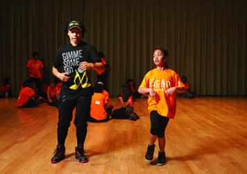 Molodi's Anglie Freeman teaches a student how to step.